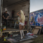 Performers get ready in makeshift dressing room